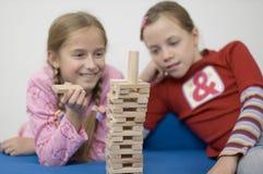 λευκό κοριτσιών παιχνιδ&iota Στοκ Εικόνες