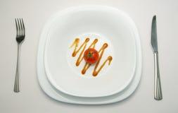 λευκό ντοματών πιάτων Στοκ Εικόνες