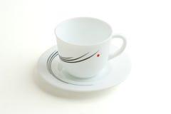 λευκό πιάτων φλυτζανιών Στοκ φωτογραφία με δικαίωμα ελεύθερης χρήσης