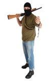 Ληστής σπασιμάτων φυλακών στη μαύρη μάσκα με το κυνηγετικό όπλο που αφαιρεί τις χειροπέδες Στοκ φωτογραφία με δικαίωμα ελεύθερης χρήσης