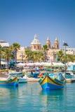 Λιμάνι και εκκλησία Marsaxlokk στοκ εικόνες