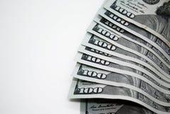 Λογαριασμοί αρκετών δολαρίων σε ένα άσπρο υπόβαθρο στοκ εικόνες με δικαίωμα ελεύθερης χρήσης