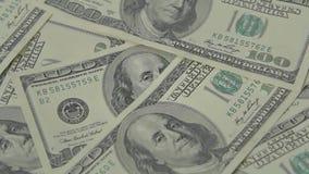 Λογαριασμοί εκατό δολαρίων της περιστροφής δολαρίων απόθεμα βίντεο