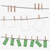 Λογαριασμοί δολαρίων που κρεμούν στο σχοινί που συνδέεται με τις καρφίτσες ενδυμάτων Στοκ εικόνες με δικαίωμα ελεύθερης χρήσης