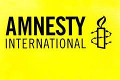Λογότυπο της Διεθνούς Αμνηστίας σε έναν τοίχο στοκ εικόνες