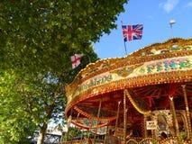 Λονδίνο εύθυμος-πηγαίνω-γύρω από Στοκ Εικόνες