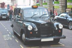 Λονδίνο, UK - 19.2010 Αυγούστου: μη αναγνωρισμένη συνεδρίαση ατόμων στο cla του στοκ φωτογραφία με δικαίωμα ελεύθερης χρήσης