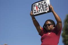 Λος Άντζελες, Καλιφόρνια, ΗΠΑ, στις 19 Ιανουαρίου 2015, ο 30ος ετήσιος Martin Luther King Jr Παρέλαση ημέρας βασίλειων, μαύρο σημ Στοκ φωτογραφία με δικαίωμα ελεύθερης χρήσης
