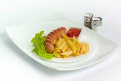 Λουκάνικα χοιρινού κρέατος με τα ζυμαρικά στοκ φωτογραφία με δικαίωμα ελεύθερης χρήσης
