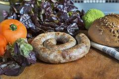 Λουκάνικο με το ψωμί και το ofoschami Στοκ Φωτογραφίες