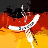 Λουκάνικο της Γερμανίας Γερμανία banger Λουκάνικο σε ένα δίκρανο Παραδοσιακή λιχουδιά στο χρώμα της σημαίας Στοκ Εικόνες
