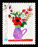 Λουλούδια στο βάζο, σχέδια παιδιών ` s - 25η επέτειος UNICEÐ  στοκ εικόνες