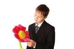 λουλούδι αγοριών που φ&alp Στοκ Εικόνα