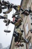 Κρεμώντας παπούτσια Στοκ Εικόνες