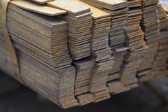 Λουρίδα σχεδιαγράμματος μετάλλων στα πακέτα στην αποθήκη εμπορευμάτων των προϊόντων μετάλλων Στοκ Φωτογραφίες