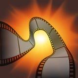 Λουρίδα ταινιών ενάντια στη λάμψη του ελαφριού υποβάθρου Στοκ Φωτογραφία