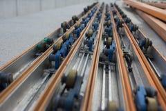 Λουρίδα δύναμης στη συνέλευση γραμμών μεταφορέων Στοκ Φωτογραφία