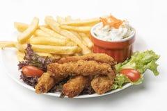 Λουρίδες κοτόπουλου με τα τηγανητά Στοκ Εικόνα