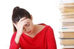 Λυπημένη γυναίκα σπουδαστής με τις μαθησιακές δυσκολίες Στοκ Εικόνες