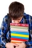 Λυπημένος έφηβος με βιβλία Στοκ Εικόνες