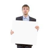 Λυπημένος επιχειρηματίας που κρατά ένα άσπρο κενό στοκ φωτογραφία με δικαίωμα ελεύθερης χρήσης