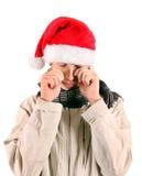 Λυπημένος νεαρός άνδρας στο καπέλο Santa Στοκ εικόνα με δικαίωμα ελεύθερης χρήσης