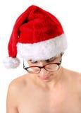 Λυπημένος νεαρός άνδρας στο καπέλο Santa Στοκ φωτογραφία με δικαίωμα ελεύθερης χρήσης