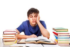 Λυπημένος σπουδαστής με βιβλία Στοκ Εικόνες