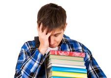 Λυπημένος σπουδαστής με βιβλία Στοκ φωτογραφία με δικαίωμα ελεύθερης χρήσης
