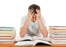 Λυπημένος σπουδαστής με βιβλία Στοκ εικόνες με δικαίωμα ελεύθερης χρήσης
