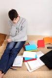 Λυπημένος σπουδαστής στο σπίτι Στοκ φωτογραφία με δικαίωμα ελεύθερης χρήσης