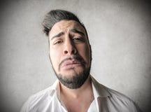 Λυπημένο άτομο με ένα τεράστιο πρόσωπο Στοκ εικόνα με δικαίωμα ελεύθερης χρήσης