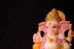 Λόρδος Ganesha σε μια σκοτεινή ανασκόπηση Στοκ Φωτογραφία