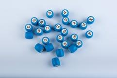 Λότο gane Μπλε πλαστικά βυτία στο άσπρο υπόβαθρο Στοκ Φωτογραφία