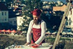 Μάγειρας ατόμων με την κυλώντας καρφίτσα Στοκ Εικόνα