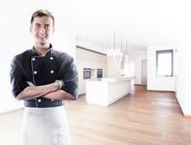 Μάγειρας με τα knifes με την κουζίνα στο υπόβαθρο, μπροστινή άποψη τρισδιάστατη απόδοση και φωτογραφία Υψηλή διάλυση Στοκ εικόνα με δικαίωμα ελεύθερης χρήσης
