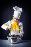 Μάγειρας με το τηγάνι και το τηγάνι Στοκ Φωτογραφίες