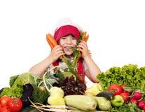 Μάγειρας μικρών κοριτσιών με τα λαχανικά Στοκ Εικόνες