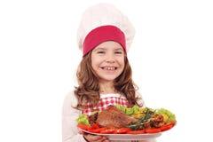 Μάγειρας μικρών κοριτσιών με το μεγάλο τυμπανόξυλο της Τουρκίας Στοκ Εικόνες