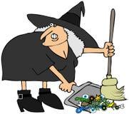 Μάγισσα που χρησιμοποιεί μια σκούπα και dustpan Στοκ Εικόνες
