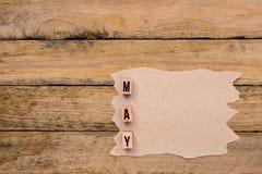 Μάιος - ημερολογιακός μήνας στα ξύλινα κεφαλαία γράμματα με το χειροποίητο έγγραφο Στοκ εικόνα με δικαίωμα ελεύθερης χρήσης