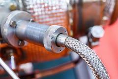 Μάνικες συνδέσεων μιας βιομηχανικής λεπτομέρειας μηχανημάτων Στοκ Φωτογραφία