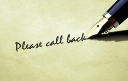 Μάνδρα που γράφει παρακαλώ την πλάτη κλήσης Στοκ εικόνα με δικαίωμα ελεύθερης χρήσης