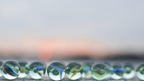 Μάρμαρα γυαλιού στο ηλιοβασίλεμα Στοκ Φωτογραφία
