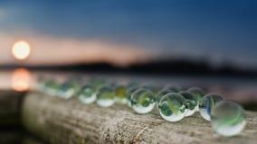 Μάρμαρα γυαλιού στο ηλιοβασίλεμα Στοκ Φωτογραφίες