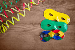 Μάσκες καρναβαλιού στο ξύλο Στοκ Εικόνα