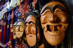 Μάσκες σε μια αγορά Στοκ Εικόνες