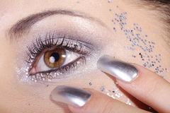 Μάτια και καρφιά στο ασήμι στοκ εικόνα με δικαίωμα ελεύθερης χρήσης
