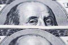 Μάτια του Benjamin Franklin ` s από έναν λογαριασμό εκατό-δολαρίων Στοκ Φωτογραφία