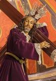 Μάλαγα - το παραδοσιακό άγαλμα του Ιησού με το σταυρό στην εκκλησία Iglesia del Σαντιάγο Apostol Στοκ Εικόνες